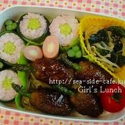 女子高生のお弁当(アスパラつくね棒と変わりカッパ巻き)