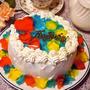 ココアスポンジde宝石を散らしようなきらきらケーキ