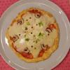 チーズのせて、スパイスのせてバージョンアップ!!なピザ