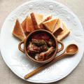 アヒージョ(そら豆、手羽元、ぶつ切り鶏、ホールトマト、にんにく)