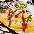 クックパッドでトップ10入り「チーズ風味のふんわり卵☆オムライス」&ポチ報告 by ジャカランダさん
