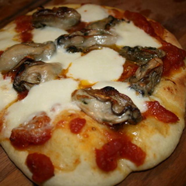 牡蠣のコンフィをのせたピザ
