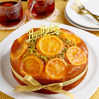 JUNA夫さんの誕生日ケーキ~オレンジと黒糖のパウンドケーキ・ホール仕立て~