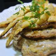 イノシシ肉とたけのこ、ホワイトアスパラのコーングリッツグリル、ポルチーニソースかけ