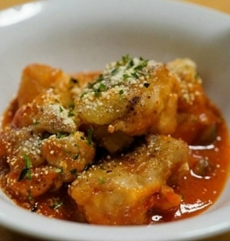 まろやかで深いコクを保証!「トマトジュース」煮のメイン料理