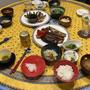 【献立】アスパラガスとえのきの豚肉巻き、じゃがいもスライスのバターソテー、菜の花のお浸し、米茄子とパプリカと椎茸のグリル、茹でカリフラワー、ピクルス、高菜のお漬物、豆腐と油揚げのお味噌汁、ビール