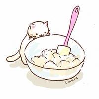 お菓子作りをてつだう猫